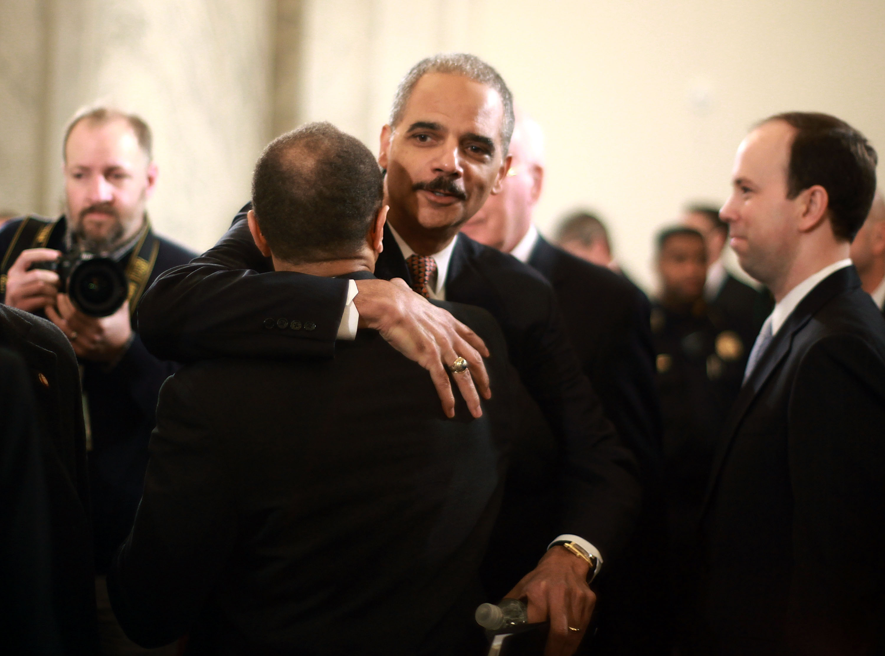 Attorney General nominee Eric Holder gives a supporter a hug.<br />