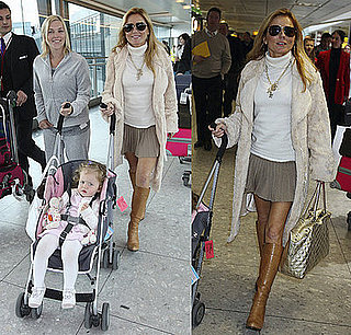 Geri Halliwell Is All Smiles at Heathrow Airport