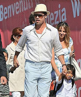 Brad Pitt Turns Photog; Who Snaps the Shots in Your Fam?