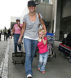 Stepmommy Sandra Bullock Shields Jesse's Daughter Sunny James at LAX