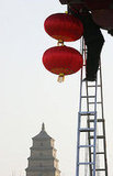 A Worker Hangs Red Lanterns