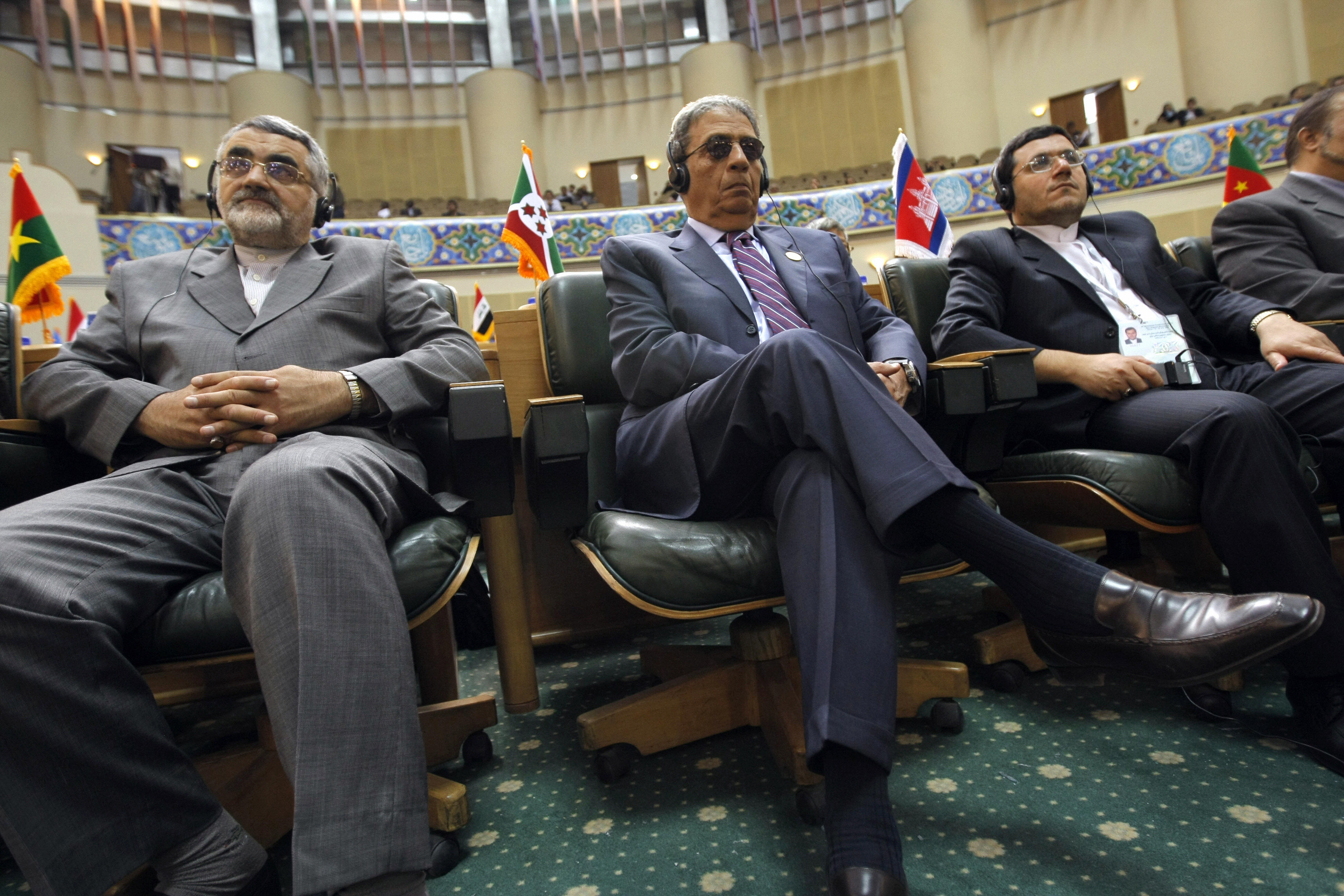 Arab League Secretary General Amr Mussa and Iranian prominent MP, Alaeddin Boroujerdi listen to the speech.