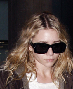 Photo of Ashley Olsen Twins at Heathrow Airport. Scruffy Hair. Love or Hate?