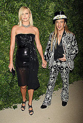 Charlize Theron and John Galliano