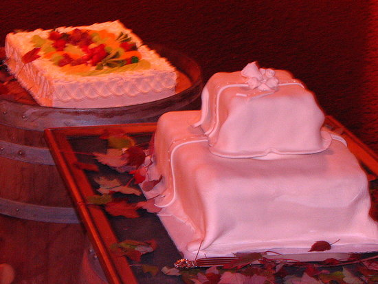 The Bride's Tres Leches cake, and Our DIY Twinkie Wedding Cake. It looks so elegant with the fondant, and everyone LOVED it!