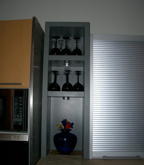 We placed this shelving unit from Bulthaup next to the sink and storage unit.