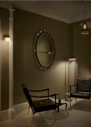 Mix light fixtures. In an entertaining space or a guest room, offering a variety of lighting solutions, such as the sconce, floor lamp, and pendant used here, lets your guests choose what works best for them. Install a dimmer so your pals can choose the brightness as well.