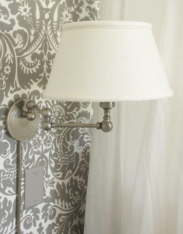 Mounted wall lamps allow for more space on bedside tables for books and other essentials.