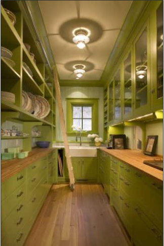 The gorgeous apple green paint in the pantry adds color to this home, while providing needed storage space for the home's antique linens and dishes.