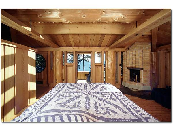 The master bedroom features large post and beam work. All of the wood used in the house was harvested and milled on the island.