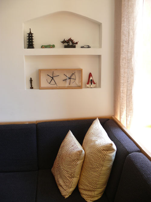 A built-in nook in the wall is the perfect place to display small knickknacks.