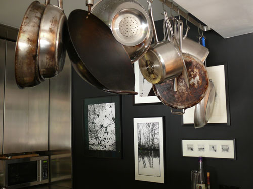 Worn-in pots and pans make an interesting sculpture hung from the ceiling.