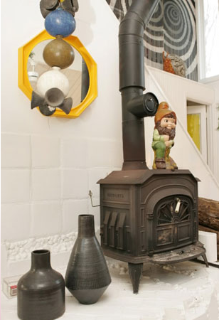 A gnome, a gift from Doonan to Adler, sits on top of the home's vintage wood-burning stove.
