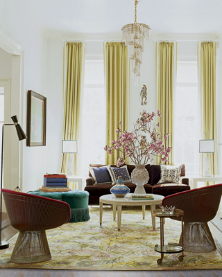 "In the living room, Nanette mixes something old (Platner chairs), something new  (Jonathan Adler table) and something ""you"" (her own rug design for Doris Leslie Blau).  To-die-for tall ceilings are showcased by long and lean curtains."