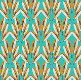 The Cavern Home Navajo Wallpaper ($310) is ethereally beautiful yet bold with a gold and white feather motif on a turquoise background.