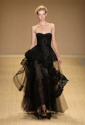 Layers of tulle and lace give this delicate black gown a bit of a rock star edge.