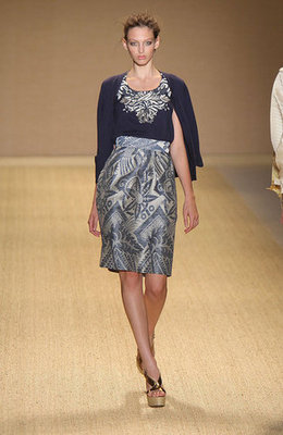 Lhuillier leans toward professional with this reserved navy skirt and cardi.
