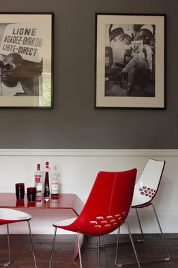 Contemporary red furniture brings a punch of color to a room based in gray tones.