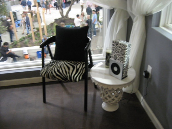 A zebra chair provides reading space in the master bedroom.