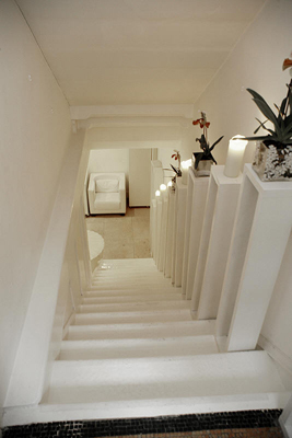 A column of pillars running up the staircase serves as additional display space.