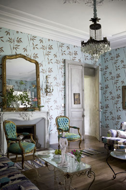 The bones of this house alone — crown moldings, fireplace, hardwood floors — are enough to make me swoon. But, the owner has added personal style with botanical wallpaper, upholstered Louis XV chairs, a gorgeous chandelier, and a bamboo mirror, taking the room to new heights of sophistication.