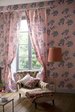 Matching drapes to your wallpaper is a bold move, but you can tame the busyness by choosing solid upholstery, lampshades, etc.