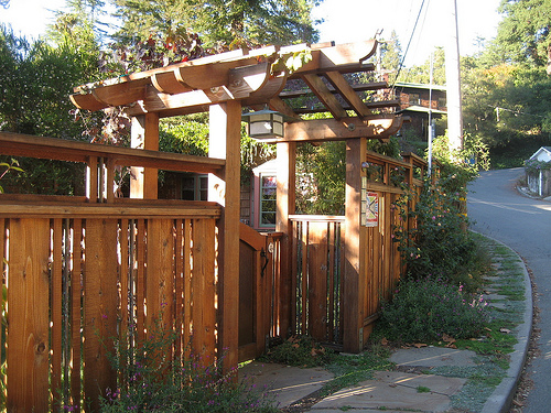 The exterior gate and fence shows a definite Craftsman influence, matching the home nicely.