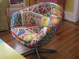 This brightly patterned chair was purchased for Laurel by a relative. It looks perfectly at ease amongst the bright colors of the living room.