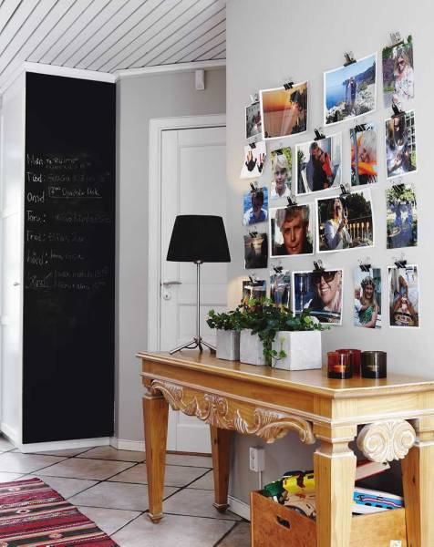 In the hall, family photos are hung neatly with the simple office clamps, and the closet is painted with chalkboard paint.