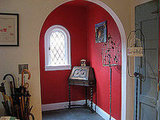 The bright-red entry wakes visitors up, and gets them prepared for an incredible tour of this quirky, unique home.