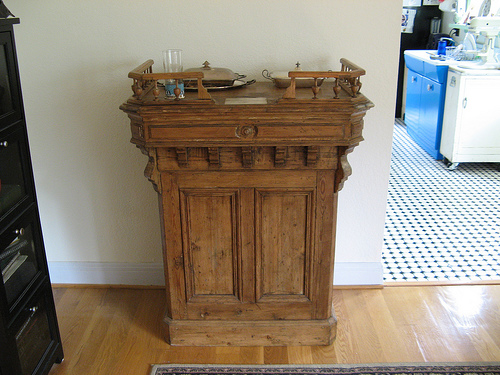 This vintage banker's teller works as a sideboard.