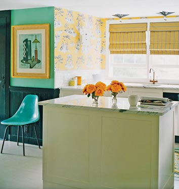 The peacock color of your dining room is really versatile . . . it plays well with others! You might try a soft yellow like the one in this photo. It looks marvelous with that cool teal. Source