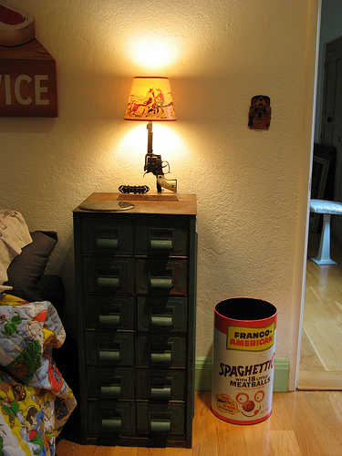 Andy's bedside table is solid steel, an old hardware store piece, and the lamp is a piece from the '50s.