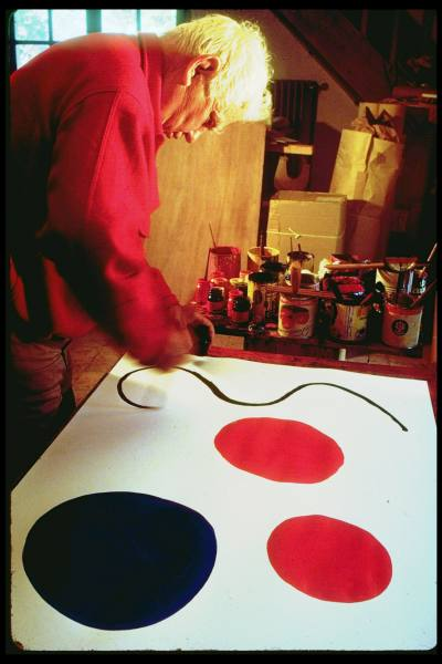 Calder plots out a design for a mobile on paper.
