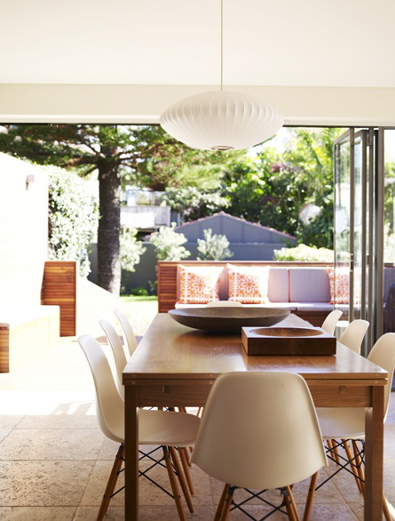 Eames plastic wire base chairs surround a simple table, and a Nelson saucer bubble lamp hovers above. What a great view!