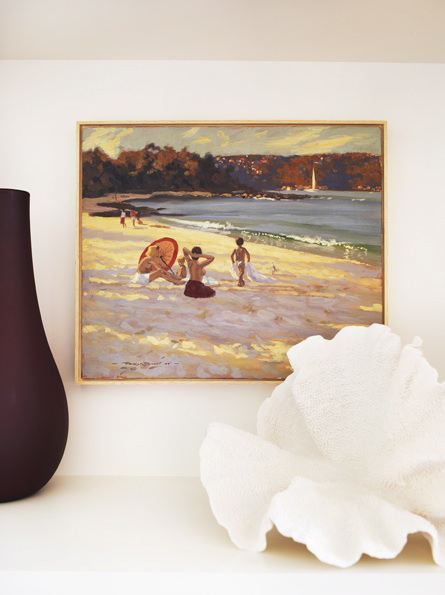 A beach vignette occupies space along the mantel.