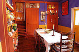Bright purple walls are certainly an unexpected visual treat in this casual dining space off the kitchen.