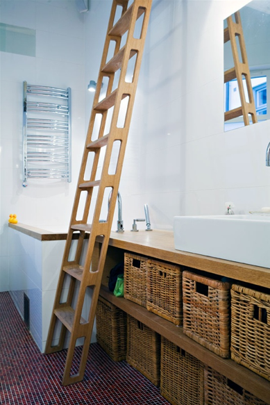 Wicker baskets conquer clutter in the bathroom.