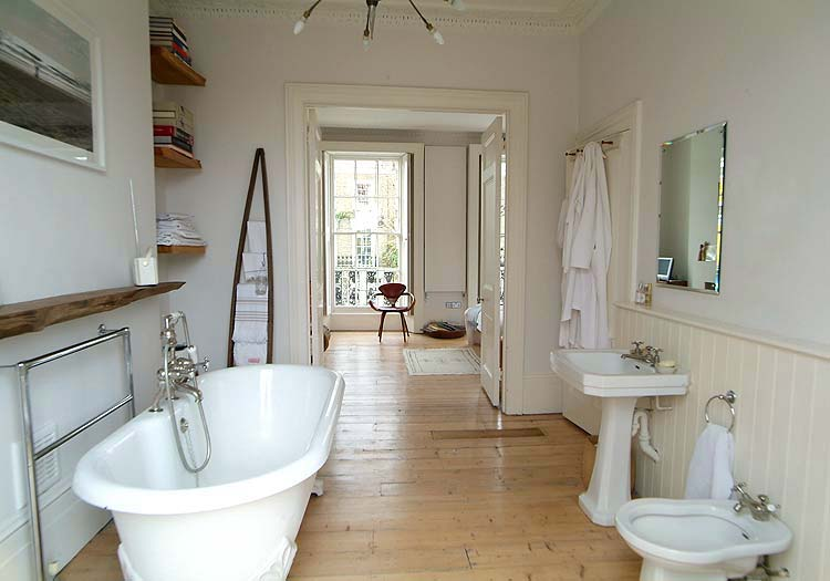 A view from this large bathroom to the bedroom is filled with gorgeous natural light.