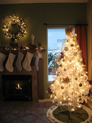 The white stockings, tree, and wreath are a fabulous match at Kimpossible's house.
