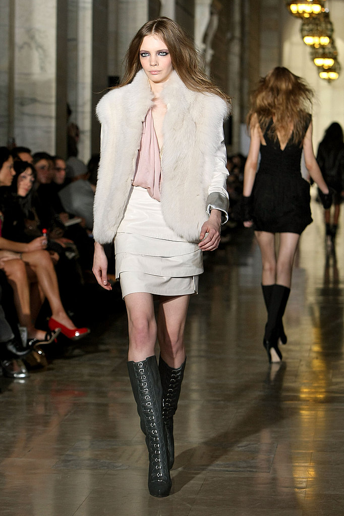 This fur vest paired with petal pleat skirt is too luxe