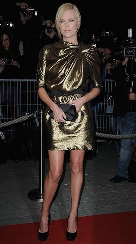 Charlize Theron Wears Gold Metallic Lanvin Dress to the Burning Plain Premiere in Paris