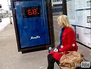Fitness First Advertisement at Bus Stop Includes a Scale