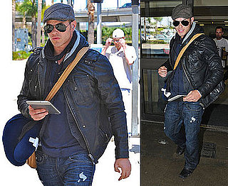 Photos of Kellan Lutz Arriving at LAX With His Kindle