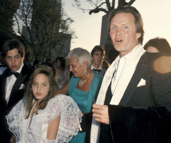 Angie got all dressed up for the Oscars in LA with Jon Voight and James Haven in 1986, when she was only 11 years old.