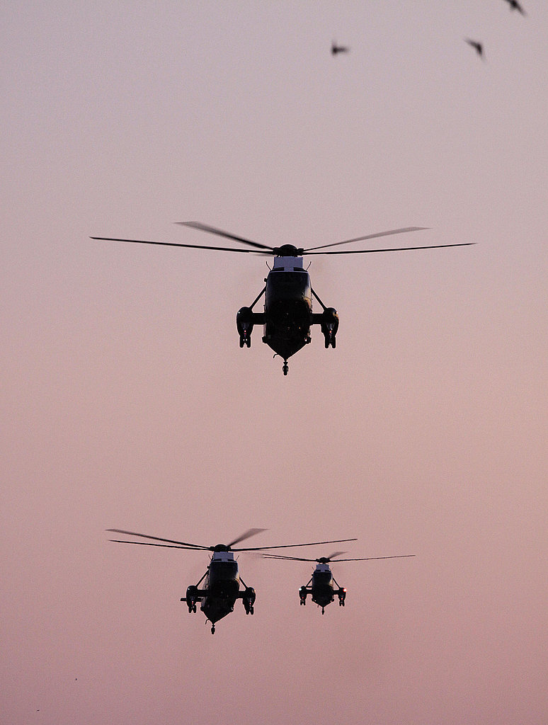 Marine One returns Sunday afternoon with two back-up helicopters behind.