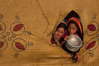 Displaced: Pakistani Girls Await Their Meals in Refugee Camp