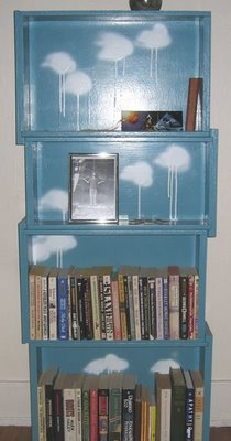 Turn dresser drawers into a stacked bookshelf.