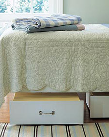 Put casters on the bottoms of drawers and slide them under your bedframe for additional storage. Source