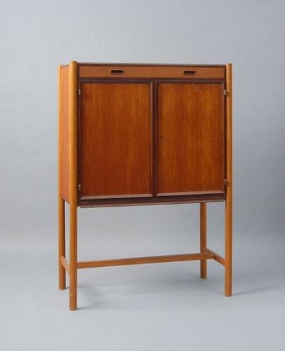 "I love the boxy shape and slender legs of the ""Manhattan"" cupboard, which is from 1960. Source"